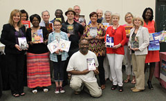 Group of local authors displaying their books