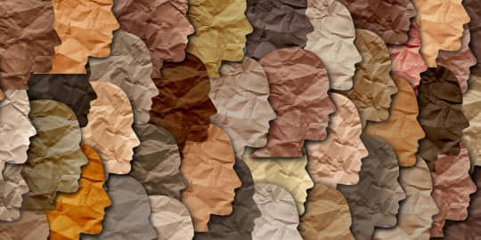 Art piece featuring paper silhouettes of human heads