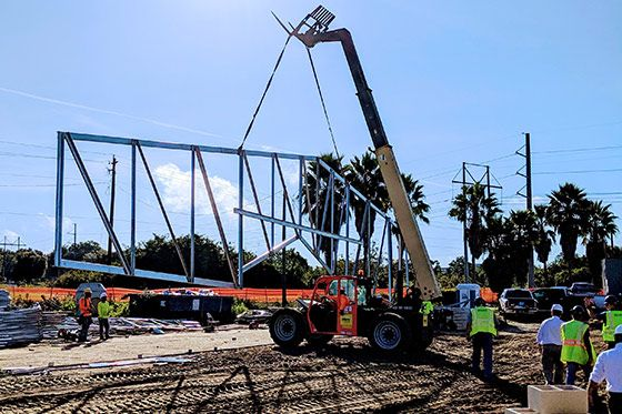 Crane moving metal framework into place
